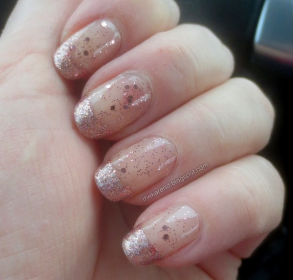 manicure with rose gold microglitter French tips and allover sparse rose gold glitter topper